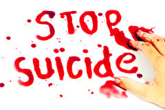 Hand-written message Stop Suicide with blood. Stock Photography