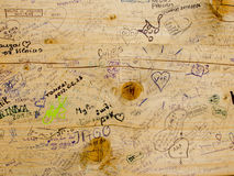 Hand written messages from visitors, travellers. Hand written  messages on the wooden board surface Royalty Free Stock Photo