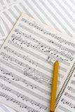 Hand written music score and pencil Royalty Free Stock Photo