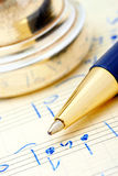 Hand- written musical notes. Ballpoint pen that is placed the handwritten music written notes (in the background shot embouchure Royalty Free Stock Images