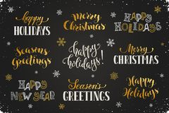Happy holidays phrases. Hand written New Year phrases. Greeting card text template with snowflakes drawn on chalkboard. Happy holidays lettering in modern Royalty Free Stock Photography