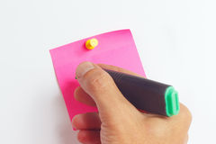 Hand written notes a green marker on a red sticker on white board Royalty Free Stock Image