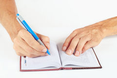 Hand written notes in pen in a notebook Stock Photos