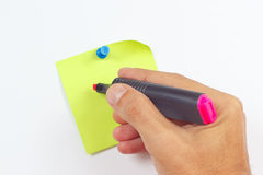 Hand written notes a red marker on a green sticker on white board Royalty Free Stock Images