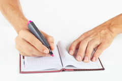 Hand written notes in red marker a notebook on white background Stock Photos