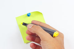 Hand written notes a yellow marker on a green sticker on white board Royalty Free Stock Photography