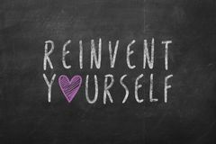 Hand written Reinvent Yourself Stock Photo