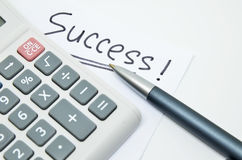 Hand written success word on paper Stock Image