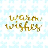 Hand written winter phrase - Warm wishes Gold glittering elegant modern brush lettering on a white background and deer blue vector Stock Images