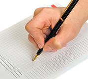 Hand Writting. Hand holding pen writing on notebook paper. Isolated on white Stock Images