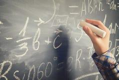 Hand writting on black board Stock Photos