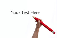Hand writting with huge red pencil copy space Stock Image