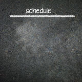 Hand writting schedule on blackboard Stock Images