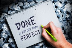 Hand wrtiting `Done is better than perfect` on a block Royalty Free Stock Photo