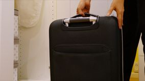 Keep the black suitcases into the wardrobe Royalty Free Stock Photos