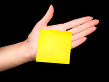 Hand with yellow blank note stick Royalty Free Stock Photos