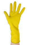 Hand in yellow glove Royalty Free Stock Photography