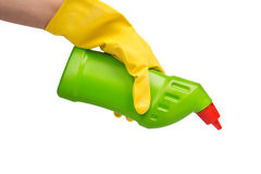 Hand with yellow glove holding cleaning product Royalty Free Stock Photos