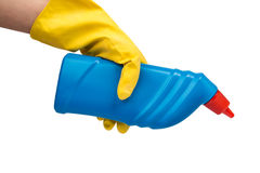 Hand with yellow glove holding cleaning product Royalty Free Stock Image