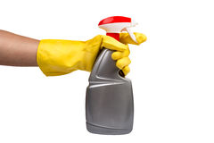 Hand with yellow glove holding cleaning product Royalty Free Stock Photo