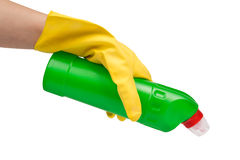 Hand with yellow glove holding cleaning product Stock Images