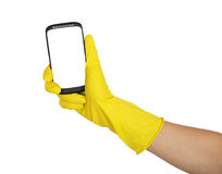Hand in yellow glove holding a mobile phone Royalty Free Stock Images