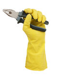 Hand in yellow glove holding a pair of pliers Stock Photos