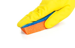 Hand in yellow glove holding rag Royalty Free Stock Image