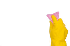 Hand in yellow glove with pink sponge Stock Photo