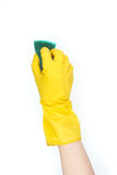 Hand in yellow glove with sponge Royalty Free Stock Images