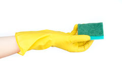 Hand in yellow glove with sponge Stock Image