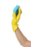 Hand in yellow glove Stock Photo