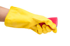 Hand in yellow glove with sponge isolated on white background Royalty Free Stock Image