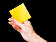 Hand with yellow memo stick isolated Stock Photography