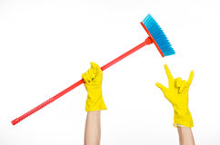 Hand in yellow rubber gloves holding a red broom  Stock Photography