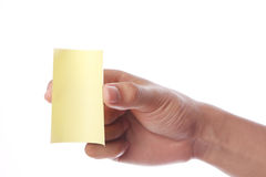Hand With Yellow Sticky Note Royalty Free Stock Photos