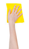 Hand with yellow washing rag isolated on white Royalty Free Stock Images