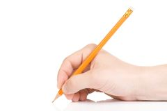 Hand and yellow wood pencil Royalty Free Stock Photography