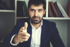 Hand you sign. Young businessman hand you sign in office royalty free stock image