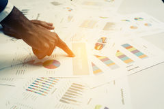 Hand of Young business people analyzing graph and chart document Royalty Free Stock Photo