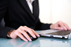Hand of Young business woman. Work with laptop Royalty Free Stock Photo