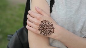 Mehndi Tattoo On Hand For Girls : Hand of young caucasian girl with floral mehndi tattoo. stock