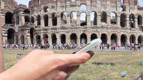 Hand young caucasian woman tourist texting on beautiful view of european ancient city with mobile smart phone stock video footage