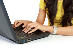 Hand of a young female working on a laptop Stock Image