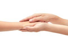 Hand of young girl holding kids hand. Isolated on white background.  royalty free stock image