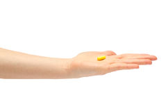 Hand of young girl holding pills homeopathy. Royalty Free Stock Photos