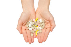Hand of young girl holding pills. Stock Photo