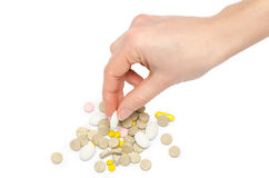 Hand of young girl holding pills Royalty Free Stock Photo