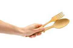 Hand of young girl holding spoon and fork. Stock Photo