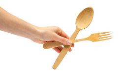 Hand of young girl holding spoon and fork. Stock Images